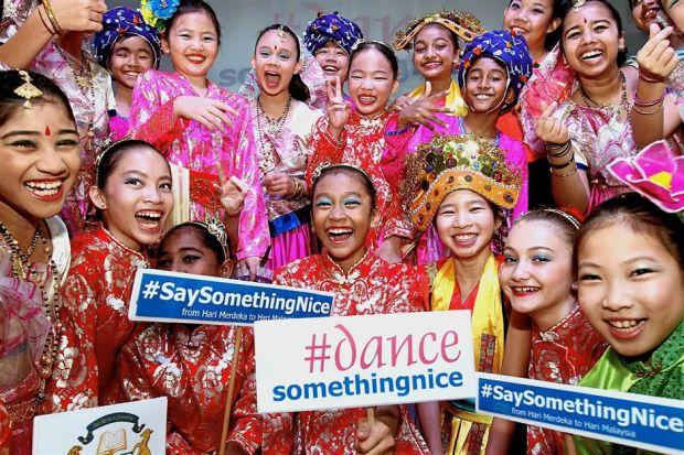 Happy together: Sri Kuala Lumpur students posing together after performing at Sri Kuala Lumpur.