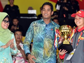 Sarawak's 12th title, buoyed by swimmers