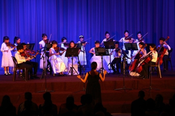 The wind band ensemble performing during Sri Kuala Lumpur International School's annual charity music showcase